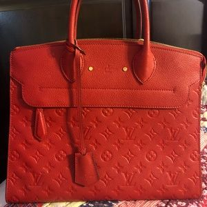 Red Authentic Louis Vuitton and matching wallet!